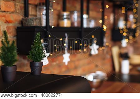 Stylish Loft Interior Of Loft Kitchen With Many Lights. Concept Of Preparing Christmas Eve And New Y