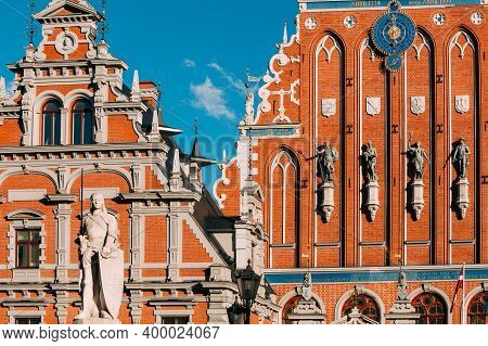 Riga, Latvia. Statue Of Roland At Town Hall Square. House Of Blackheads. Sunny Summer Day With Blue