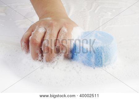 Housewife Cleaning The Floor With Blue Sponge