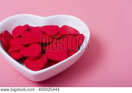 Hearts In A Saucer In The Shape Of A Heart On A Pink Background.