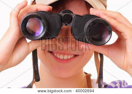 Smiling Young Girl Looking Through Binoculars