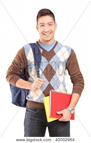A handsome male student school bag holding books isolated against white background