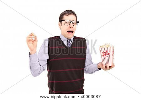 Afraid man holding a popcorn box isolated on white background
