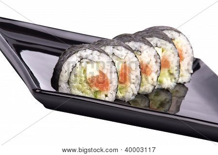 Sushi - Roll On A Black Plate Isolated