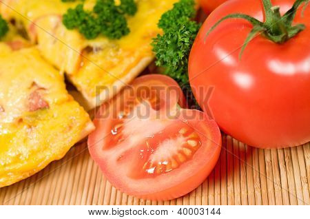 Pizza With Tomatoes And Parsley Close Up