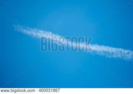 Cloudscape With Trail Of Jet Plane On Blue Sky. Nature Background