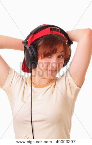 Attractive Young Girl Listens To The Music On Headphones