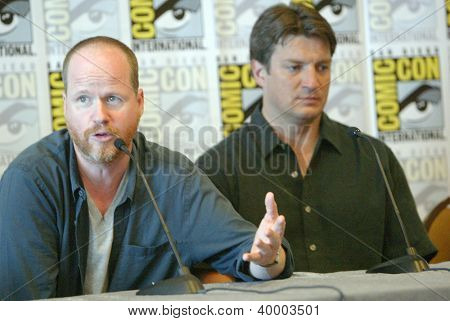 "SAN DIEGO, CA - JULY 13: Joss Weedon and Nathan Fillion attends a  press conference for ""Firefly"" at the 2012 Comic Con convention press room at the Bayfront Hilton on July 13, 2012 in San Diego, CA."