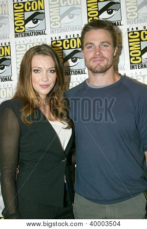 SAN DIEGO, CA - JULY 13: Katie Cassidy and Stephen Amell arrive at the 2012 Comic Con convention press room at the Bayfront Hilton Hotel on Friday, July 13, 2012 in San Diego, CA.