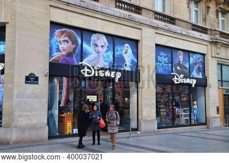 Paris, France - December 10, 2019: People Shop At Disney Store In Avenue Champs-elysees, Paris, Fran