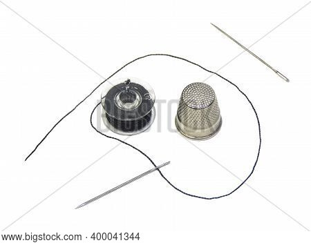 Sewing Kit Isolated On A White Background. A Sewing Machine Reel With A Black Thread Wound On It, A