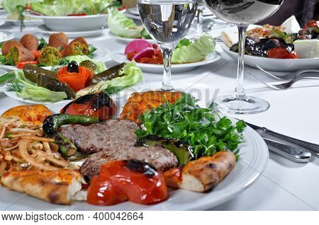 A Magnificent Dining Table And Grilled Lamb Chop Steak Kebab In A Luxury Restaurant, Turkish Grilled