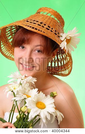 Happy Young Girl In The Hat With Chamomile Flowers
