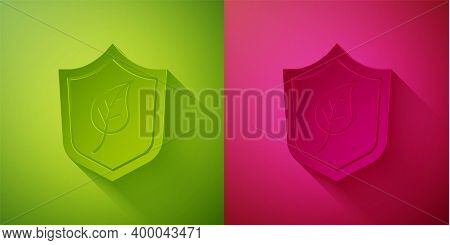 Paper Cut Shield With Leaf Icon Isolated On Green And Pink Background. Eco-friendly Security Shield