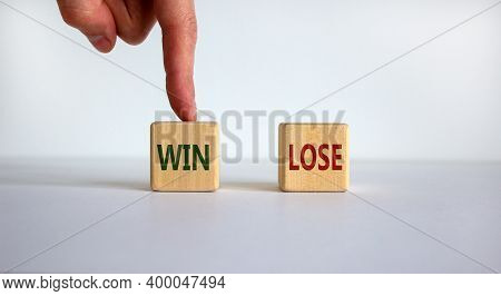 Win Or Lose. Close Up Customer Hand Choose Win Or Lose Icon On Wood Cube. Service Rating. Business A