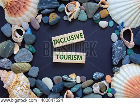 Inclusive Tourism Symbol. Words 'inclusive Tourism' On Wooden Blocks On A Beautiful Black Background
