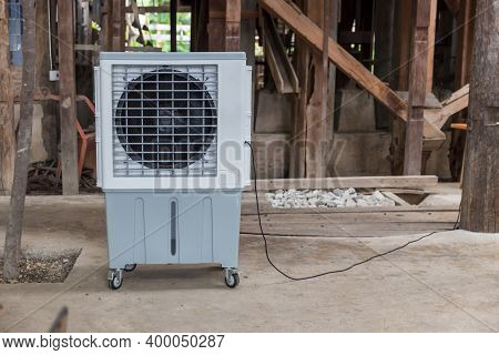 Evaporative Air Cooling Fan. Air Conditioning. Portable Air Cooler And Humidifier On Casters. Mobile