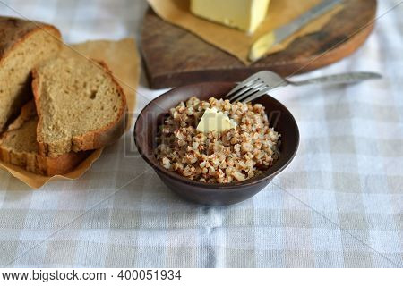 Buckwheat Porridge With Butter.bowl Of Tasty Buckwheat Porridge On Wooden Table.healthy Breakfast Fo