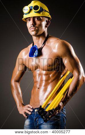 Construction worker in dark studio