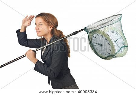 Businesswoman with net and clocks