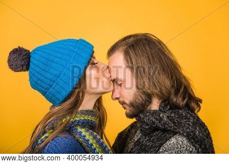 Happy Couple In Warm Clothes. Couple In Love. Woman Kiss Man In Forehead. Autumn Time. Winter Time.