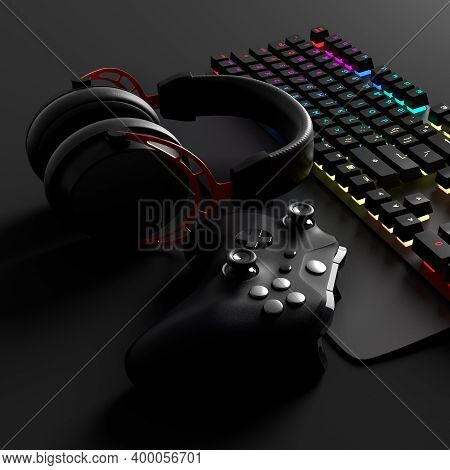 Top View Of Gamer Workspace And Gear Like Mouse, Keyboard, Joystick, Headset, Vr Headset On Black Ta