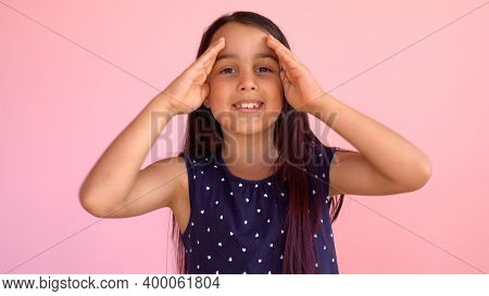 Girl Playing Hide And Seek Portrait. Cute Little Girl Open Her Face With Hands. Playing Hide And See