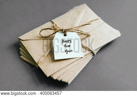 A Bundle Of Letters Tied With String On A Bow. The White Tag Is Attached To A Bundle Of Envelopes. A