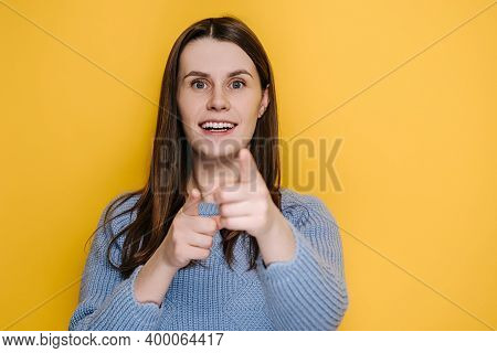 Amazed Funny Millennial Young Girl Pointing Finger To Camera, Looking Big Eyes Surprised Expression,