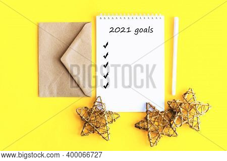 Notepad And Decorative Stars On A Yellow Background. Christmas Background For Design And Text. Yello