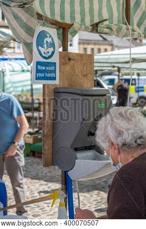 Richmond, North Yorkshire, Uk - August 1, 2020: An Elderly Woman Wearing A Face Mask At A Hand Washi