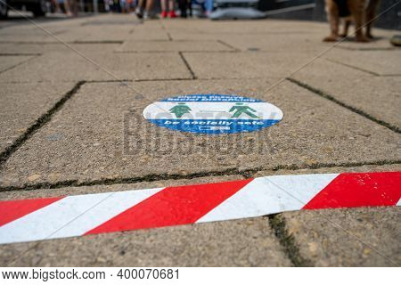 Richmond, North Yorkshire, Uk - August 1, 2020: A Sticker On A Floor With Tape To Mark Queues In Ric