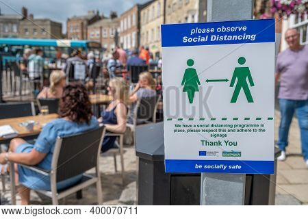 Richmond, North Yorkshire, Uk - August 1, 2020: A Sign Asking People To Observe Social Distancing Wi
