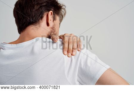 Bearded Man Touching Shoulder With Hand Pain Dislocation Medical Intervention