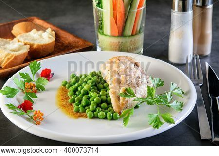 White Festive Dish With Fried Chicken Breast And Broiled Green Peas On The Dack Background. White Br