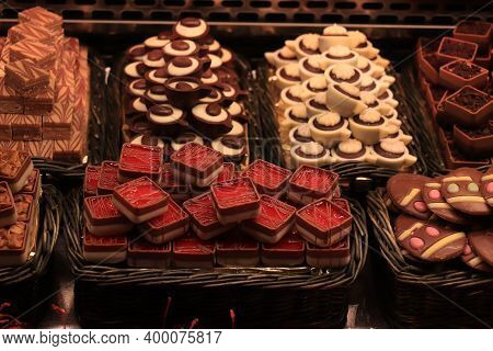 Luxurious Chocolate Pralines, Fruit Filled Squares, At A Market In Barcelona, Spain