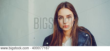 Portrait Of A Brunette Girl 19-20 Years Old. Beautiful Girl