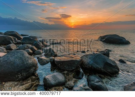 Tropical beach at beautiful sunset. Nature background. Nai Yang beach. Phuket. Thailand