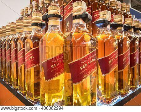 Belgrade, Serbia - November 29, 2020: Johnnie Walker Red Label Whisky Logo On Some Bottles For Sale.