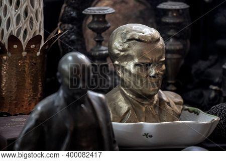 Belgrade, Serbia - October 9, 2020: Bust Of Marshal Josip Broz Tito Facing A Small Statue Of Vladimi