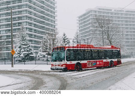 Toronto, Ontario, Canada - November 22, 2020: Toronto Public Transport Ttc Red Bus During Heavy Wint