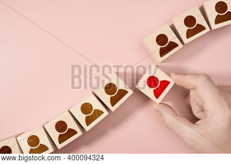 Hand Choosing A Wooden Person Block From A Set. Employment Choice Concept. Human Resources Hr Manage
