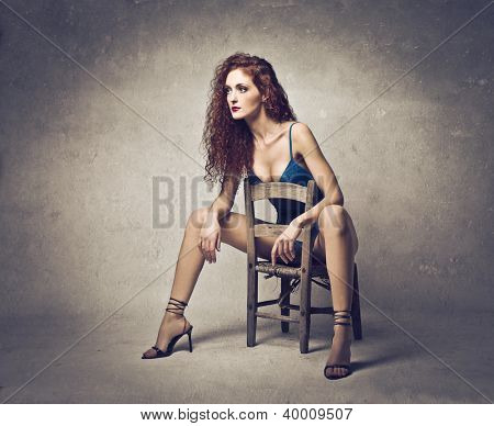 Sexy woman sitting in a provocative way