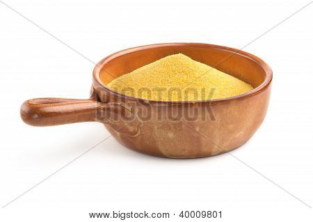 maize flour in earthenware bowl on white background