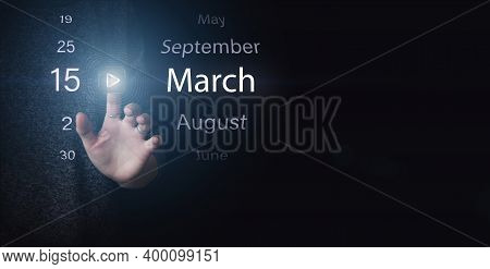March 15th. Day 15 Of Month, Calendar Date. Hand Click Luminous Icon Play And Date On Dark Blue Back