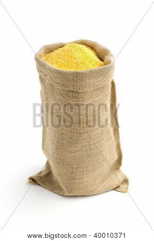 linen bag with corn flour isolated on white background