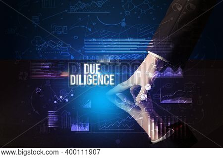 Businessman touching huge screen with DUE DILIGENCE inscription, cyber business concept