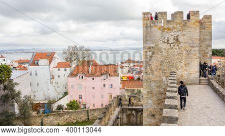 Lisbon, Portugal - March 4, 2016: Tourists Walking On Castelo De San Jorge Or Saint George In Lisbon
