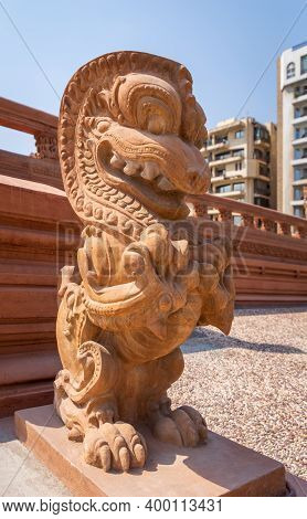 Angled View Of Dragon Statue, An Indonesian Sculpture, In Front Of Baron Empain Palace, A Historic M