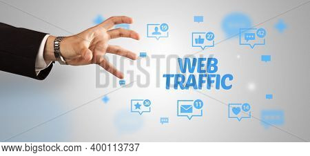 Close-Up of cropped hand pointing at WEB TRAFFIC inscription, social networking concept